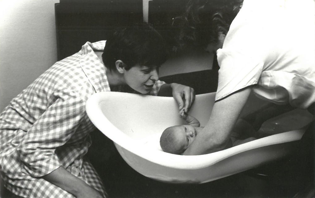 mum-bathing-a-baby