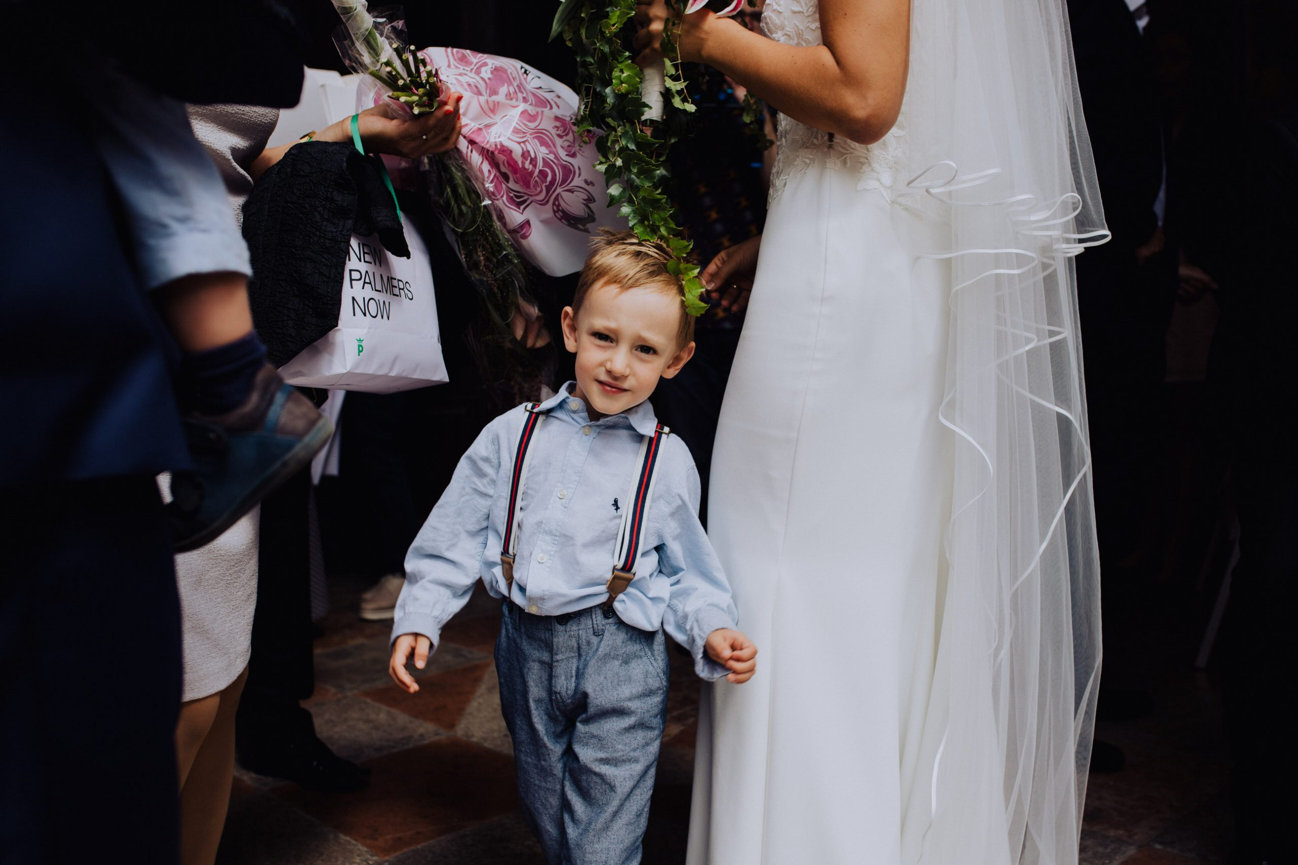 kid together with wedding couple